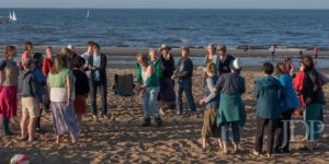 Crowd of singers on the beach