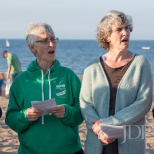 Singers singing on the beach