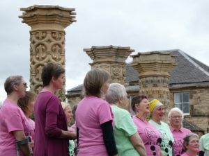 The choir by the pillars in Portobello community garden