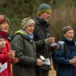 Singers in the orchard with ivy crowns